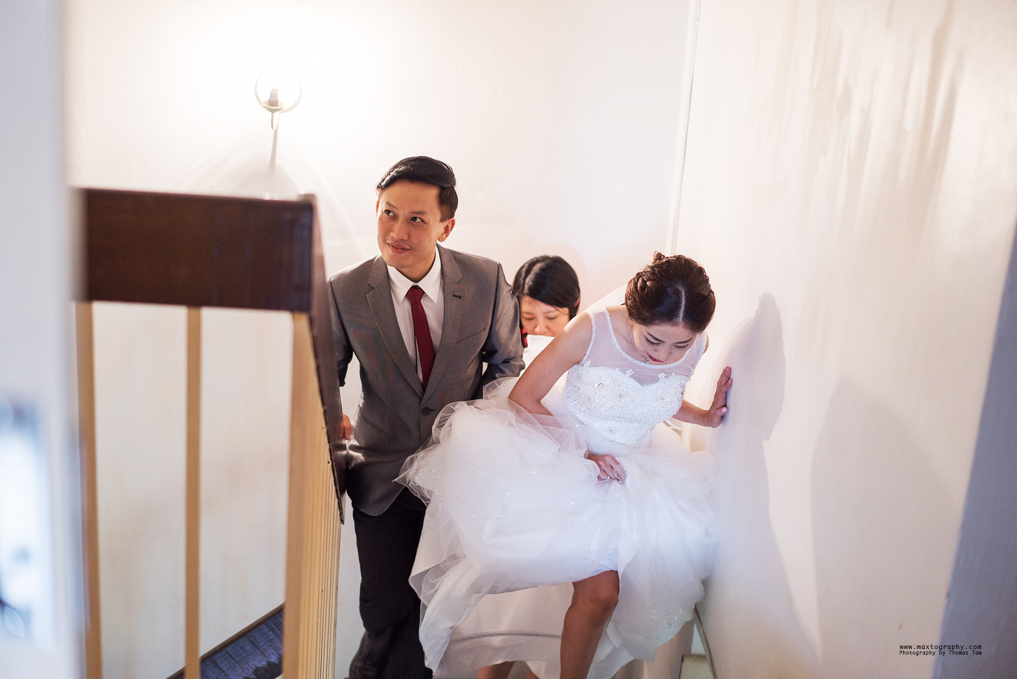 Groom & Bride on staircase