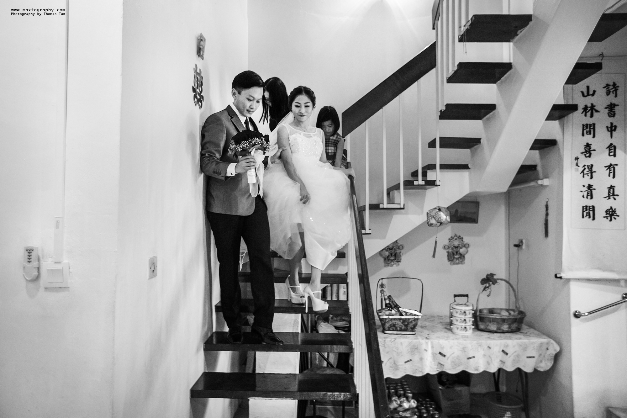 Groom and bride walking downstairs