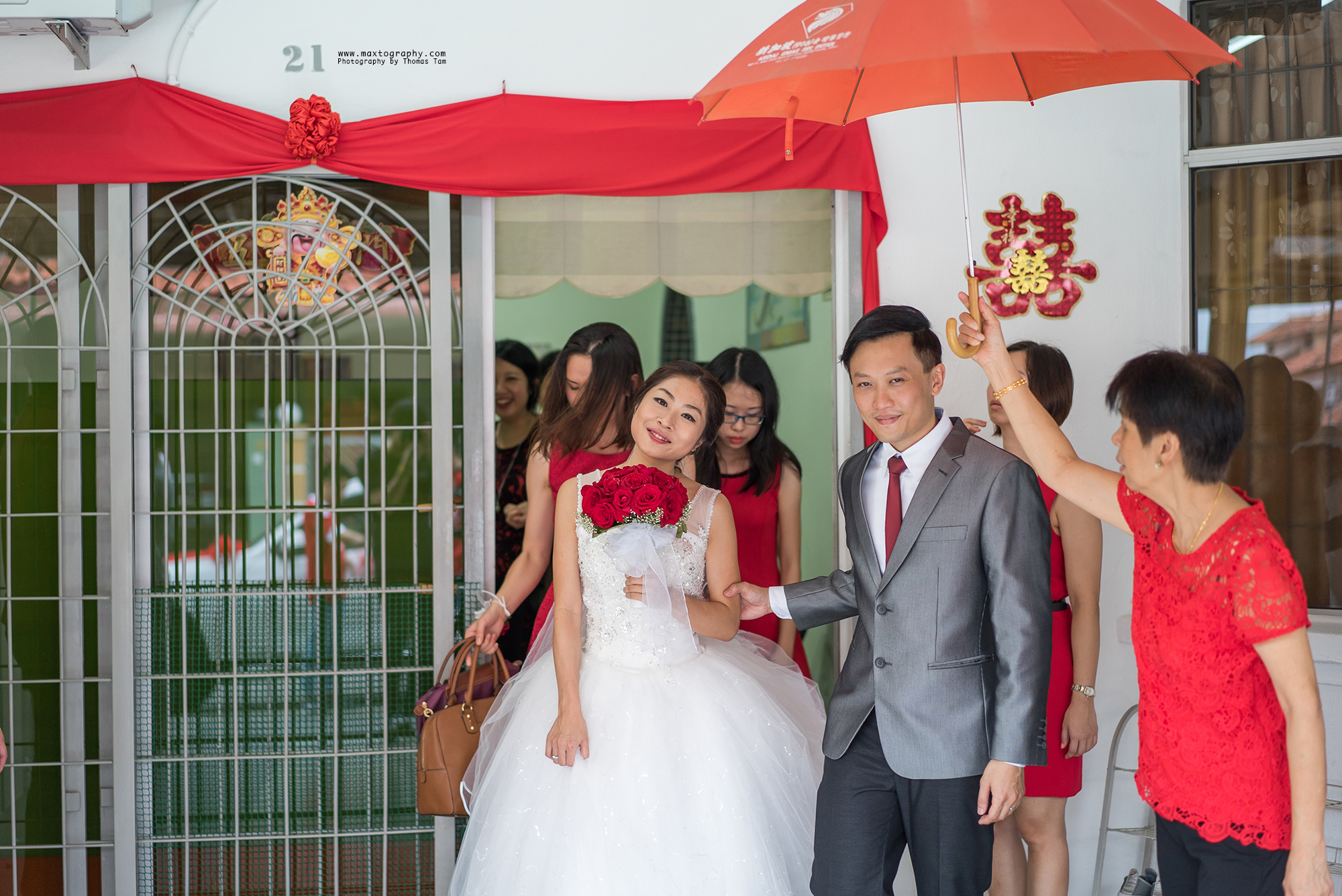 bride and groom accompany by auntie