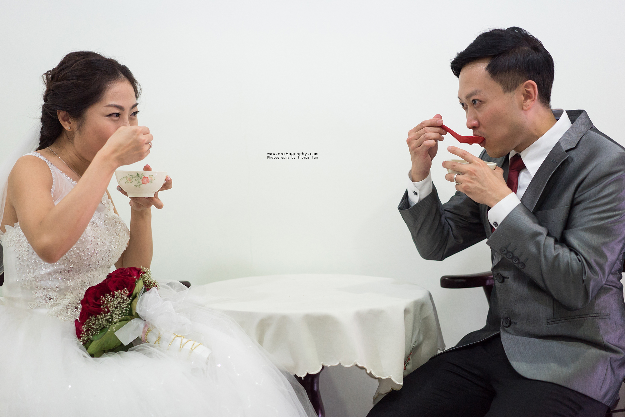 bride and groom eating Tang Yuan