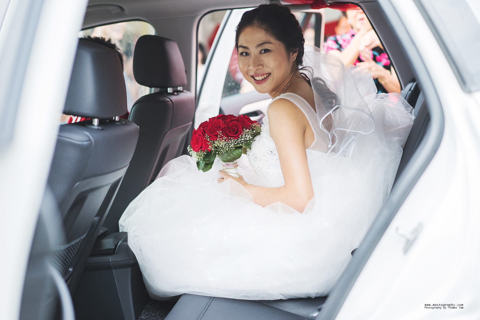 bride smiling in car