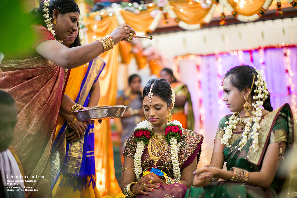 Bride receiving holy water blessing