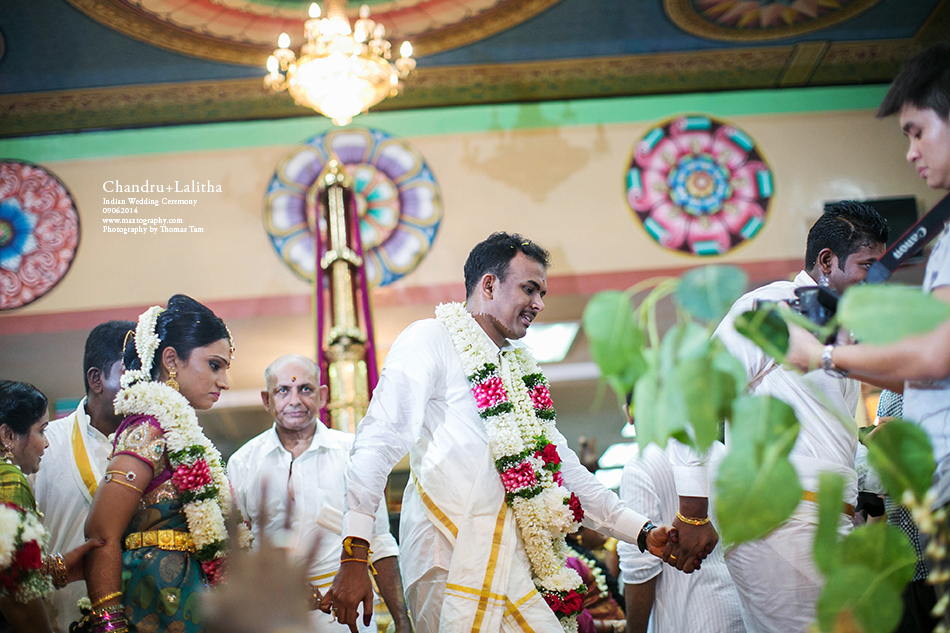 Groom and bride hand in hand
