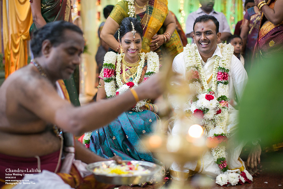 Indian bride and groom smilling