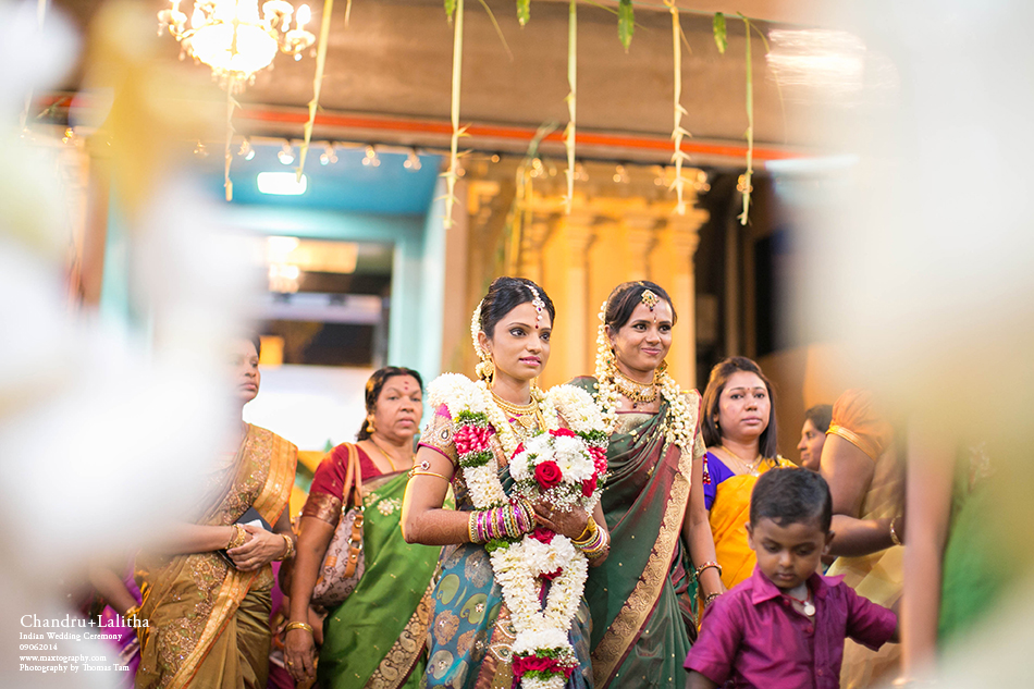 Indian bride with bridesmaid smiling