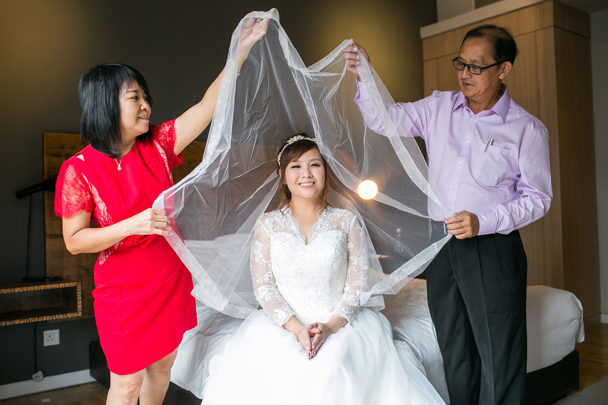 Parents veiling bride