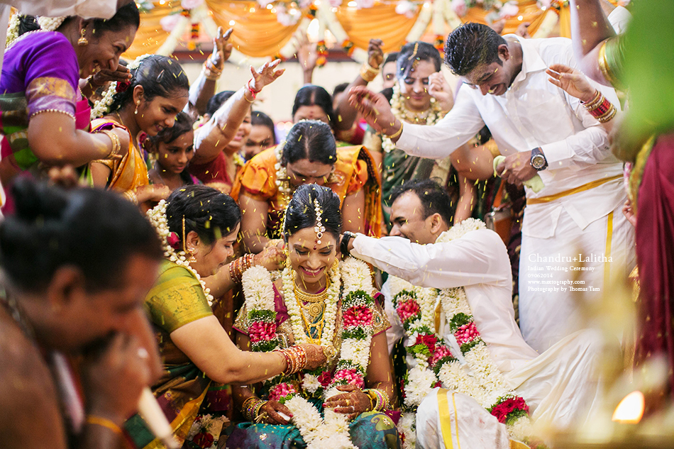 Throwing rices to bride and groom for blessing close up