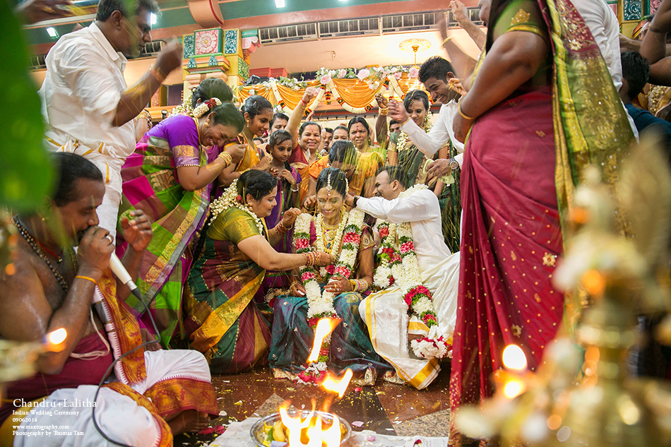 Throwing rices to bride and groom for blessing