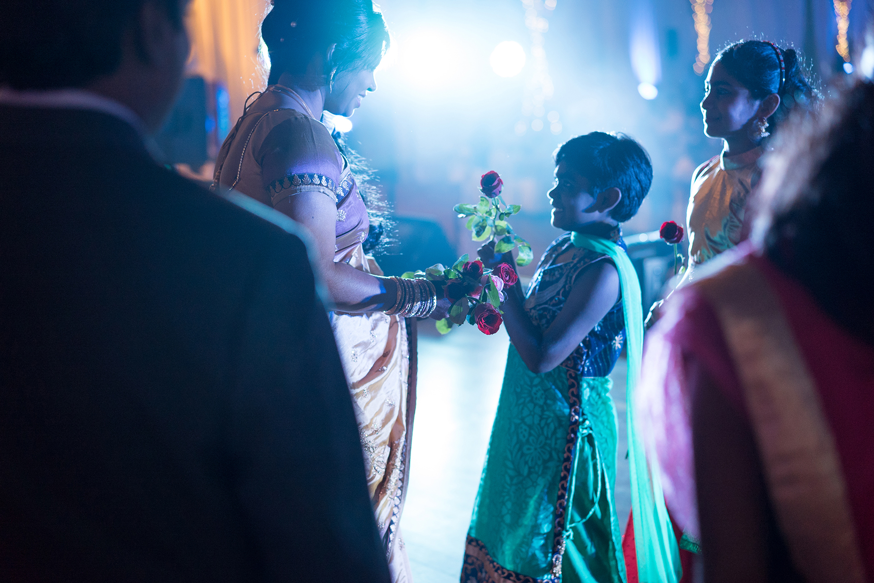 bride receiving flowers from little girl