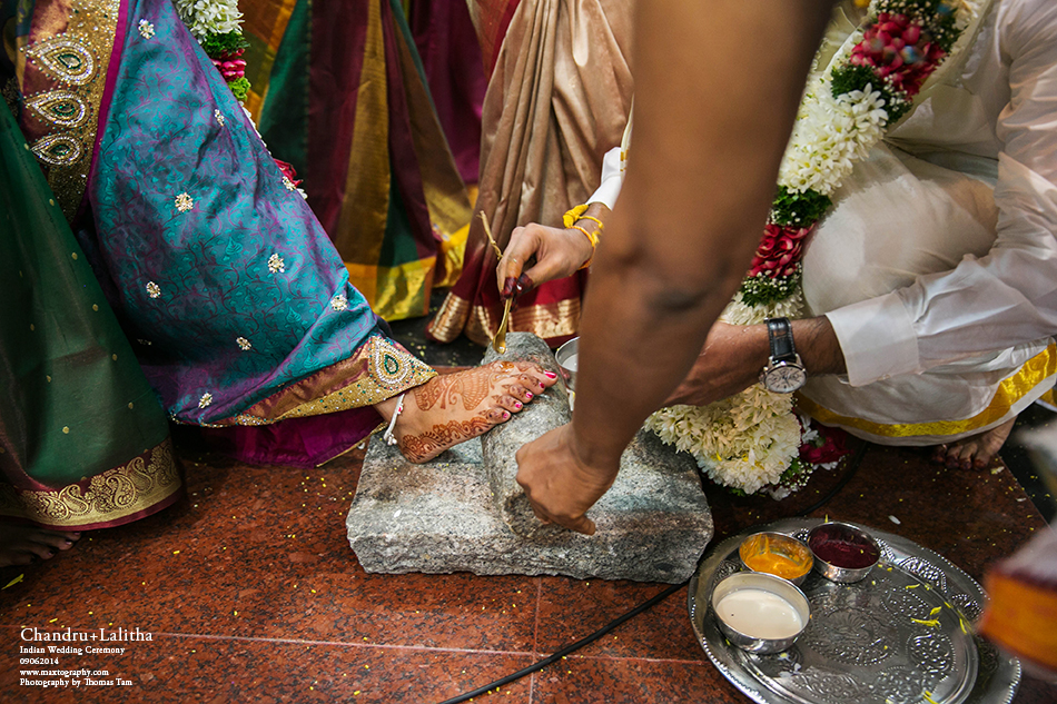 groom blessing bride foot