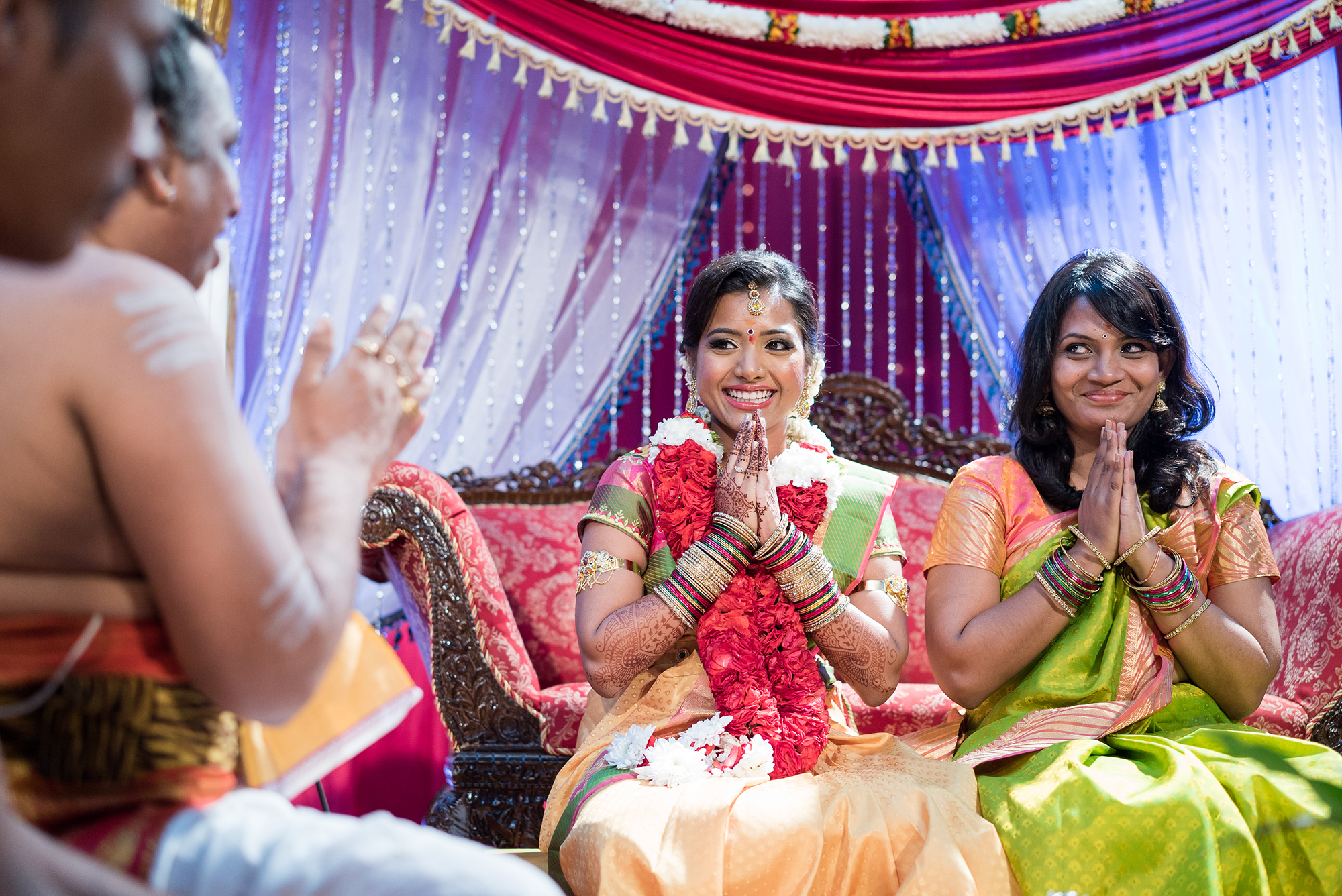 Bride and bridesmaid smiling
