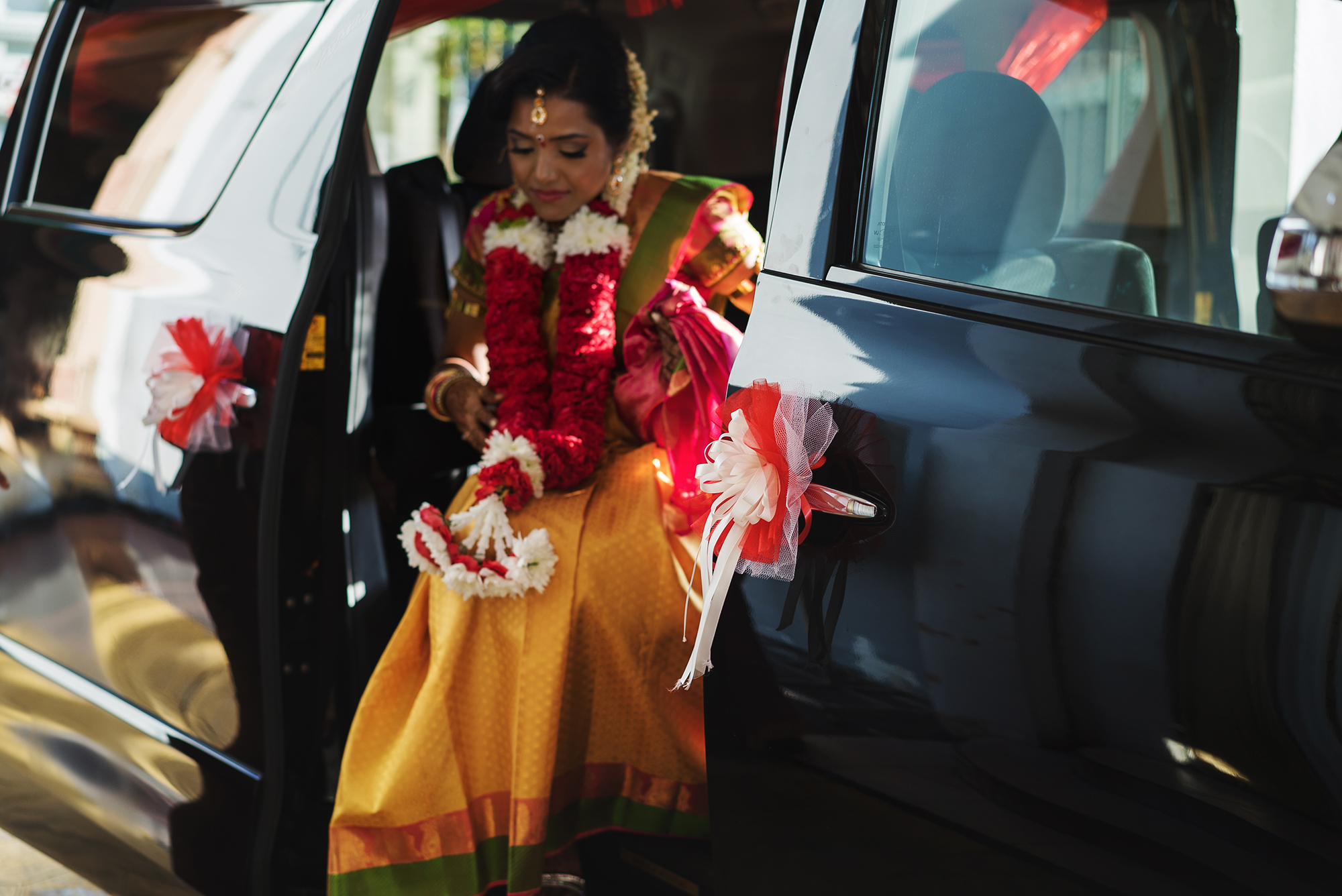 Bride getting out from the car