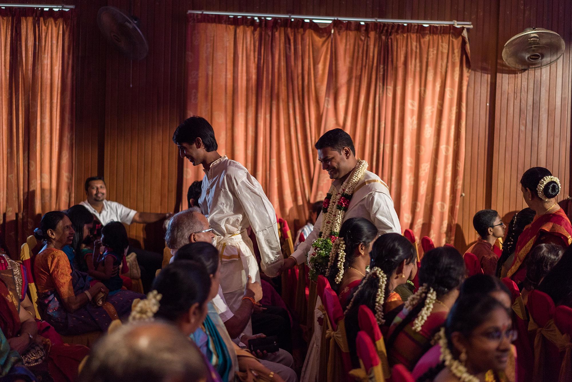 Indian groom and groomsmaid leaving