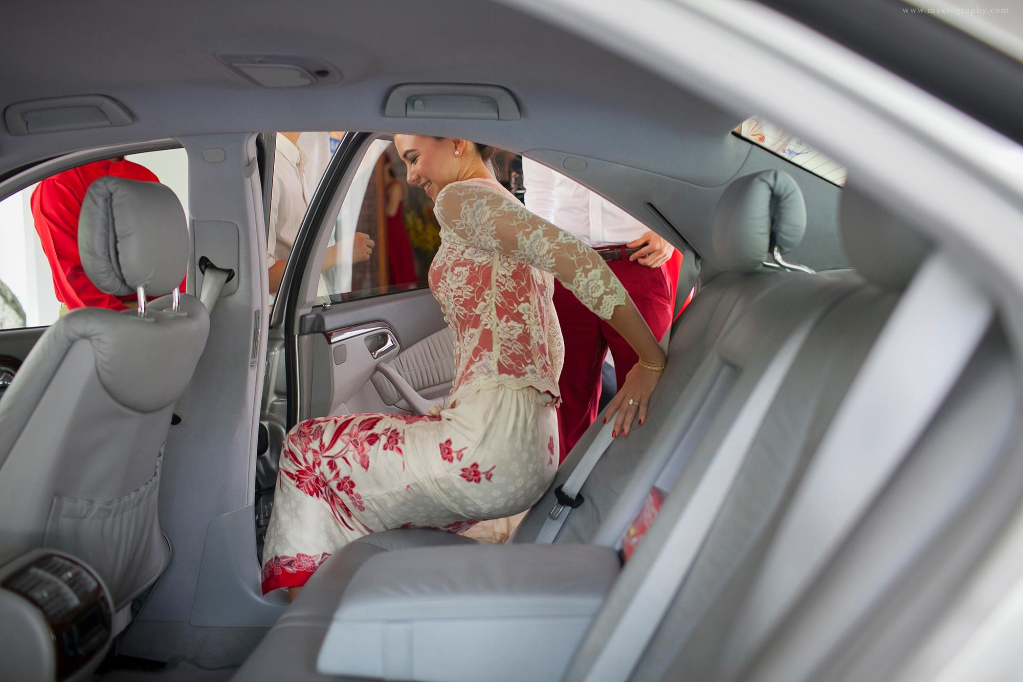 bride entering the car