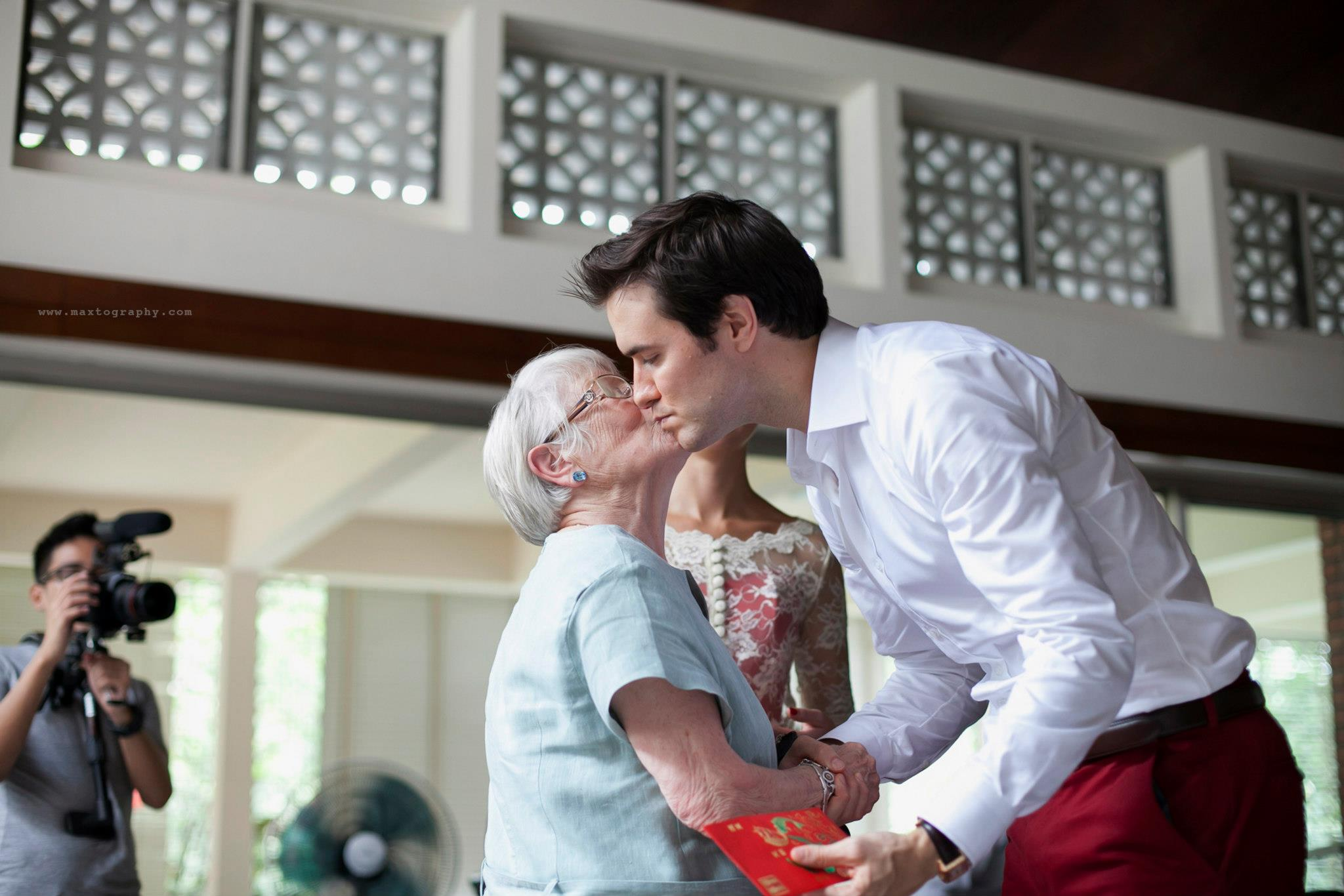 groom kisses grandma