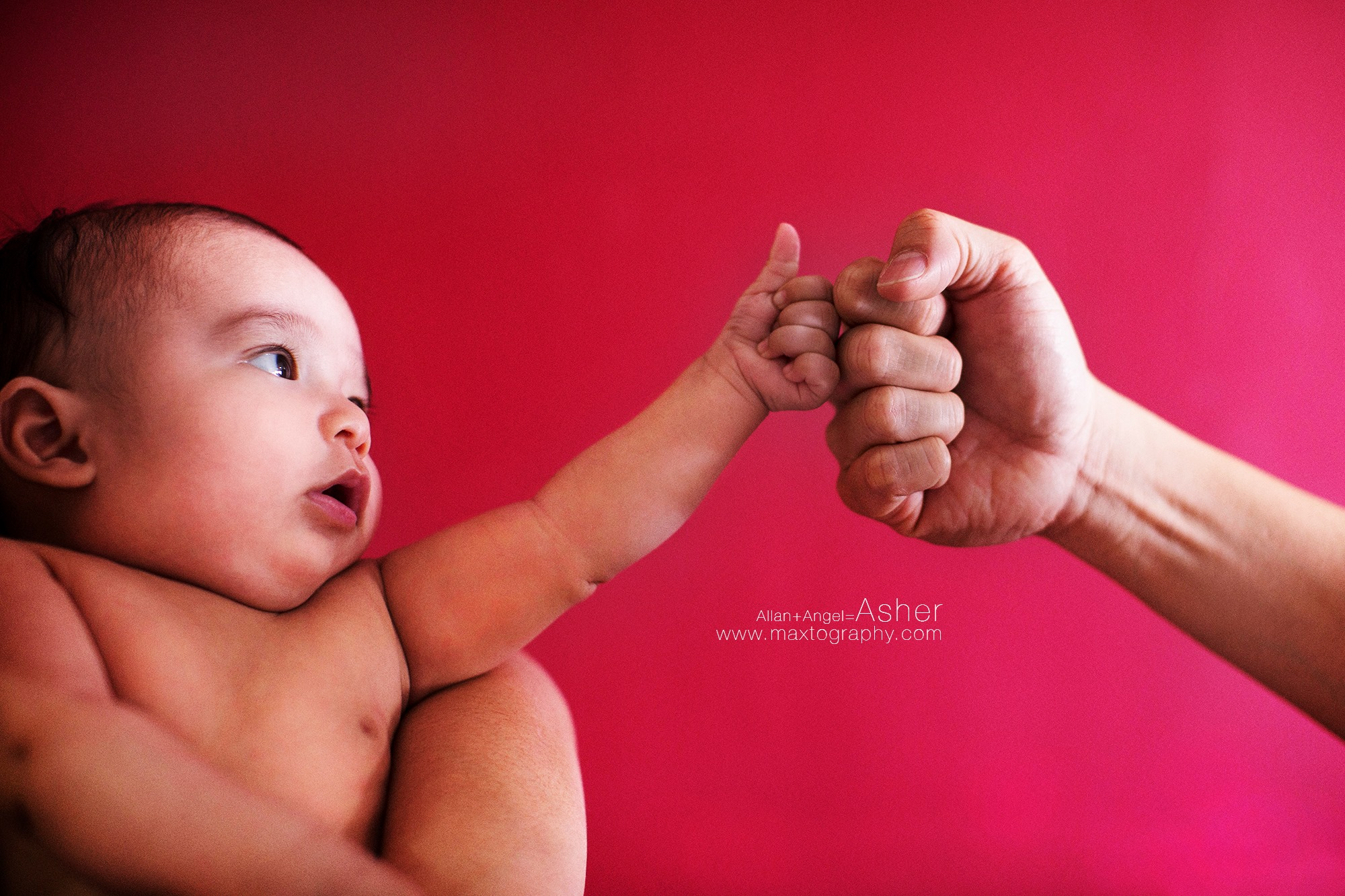 baby hand punch with father