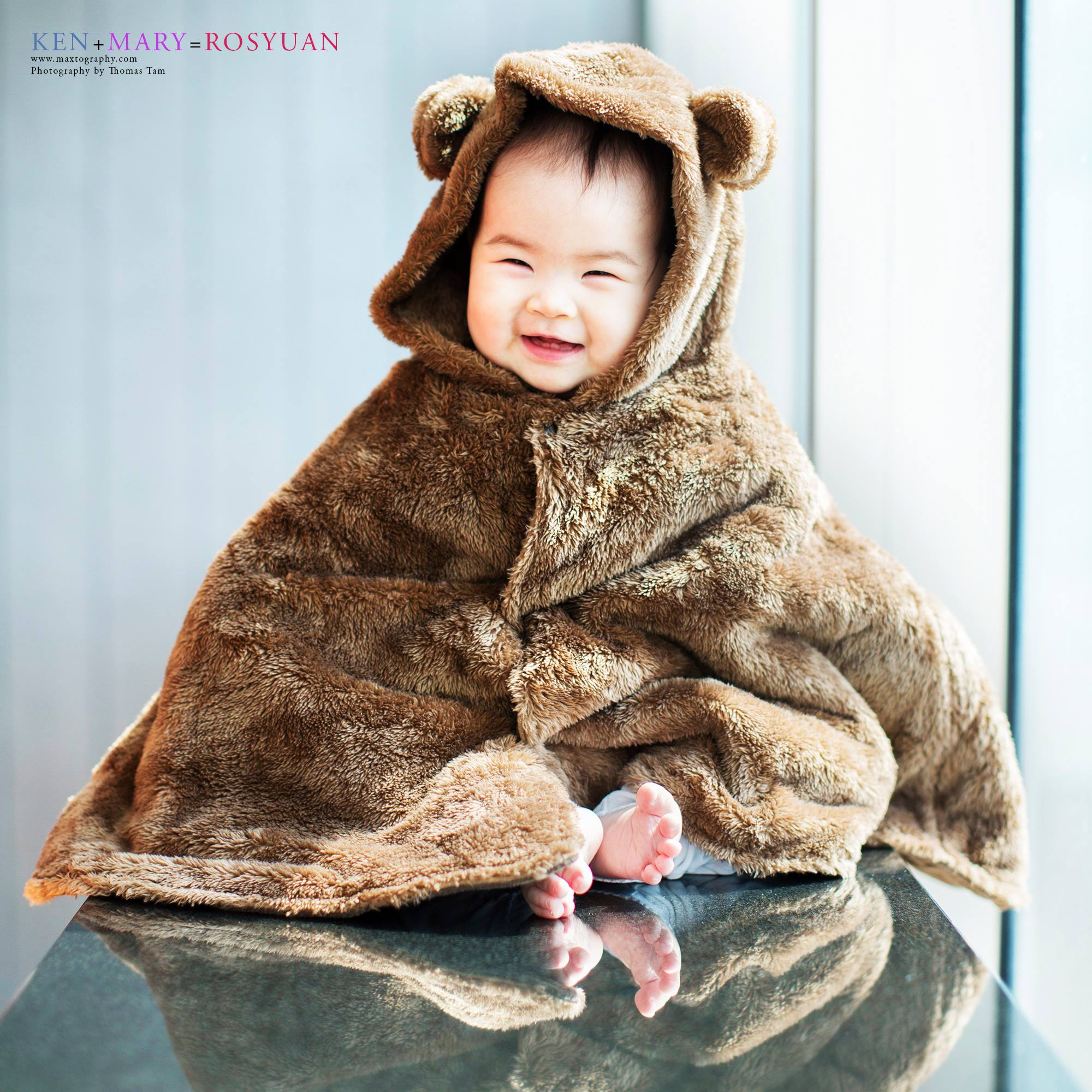 baby in bear suit