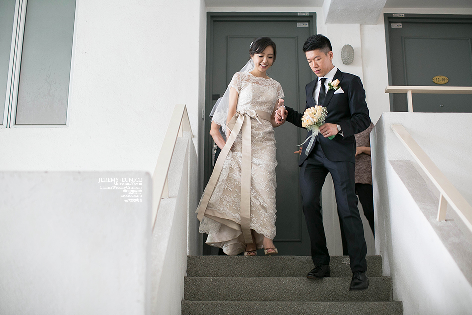 bride and groom coming down from staircase