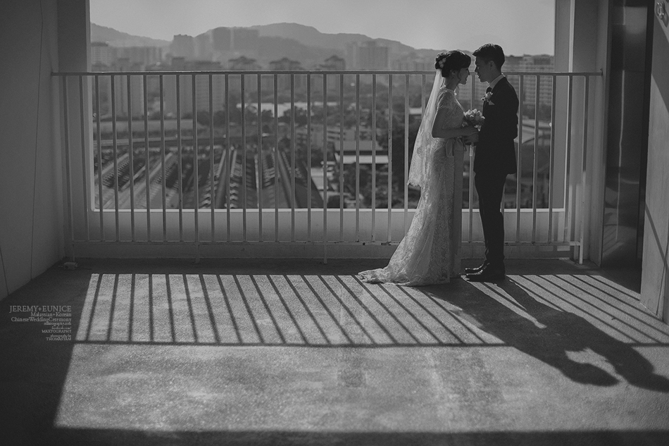 bride and groom pose in shadows