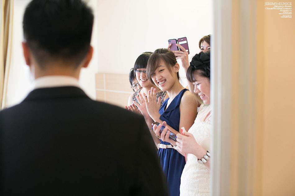 bridesmaid welcoming groom
