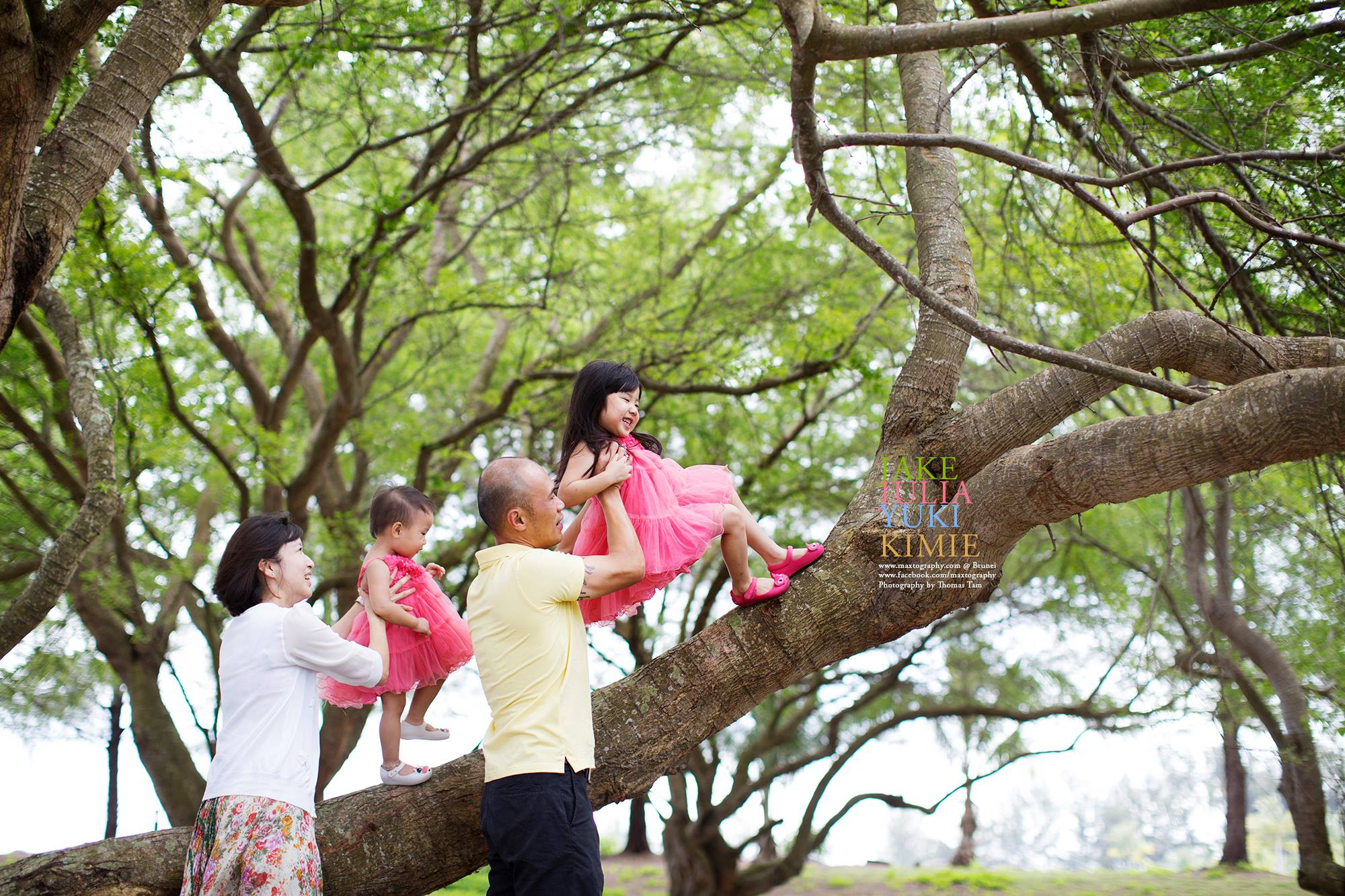 family having fun on the tree bench