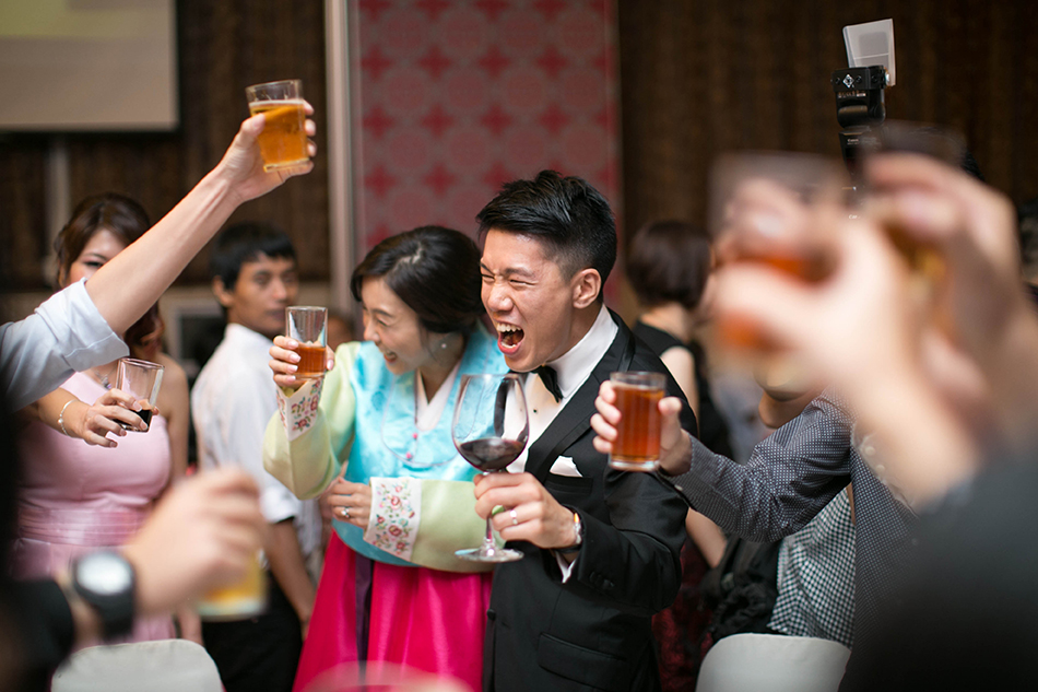 groom toasting with passion