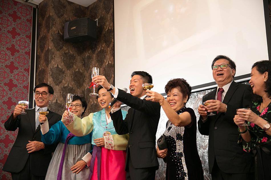 groom toasting