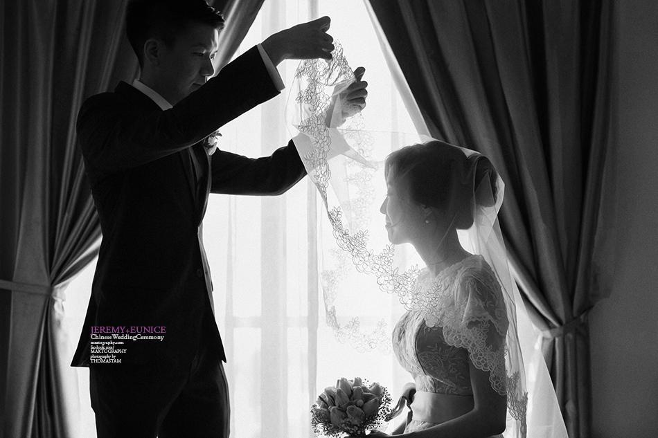 groom unveliling bride head veil