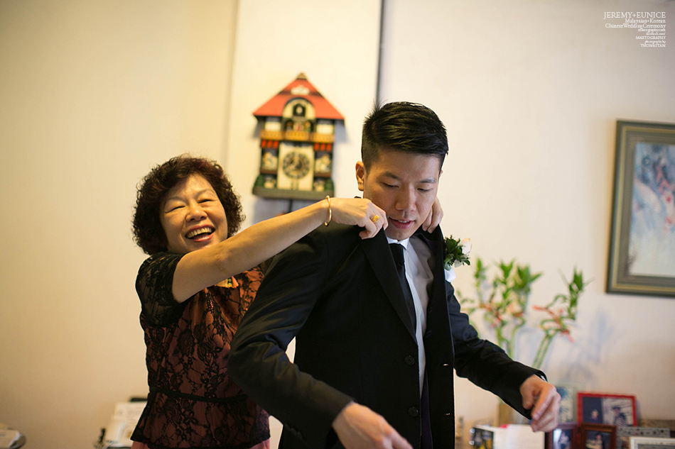 mother wearing blazer for her son