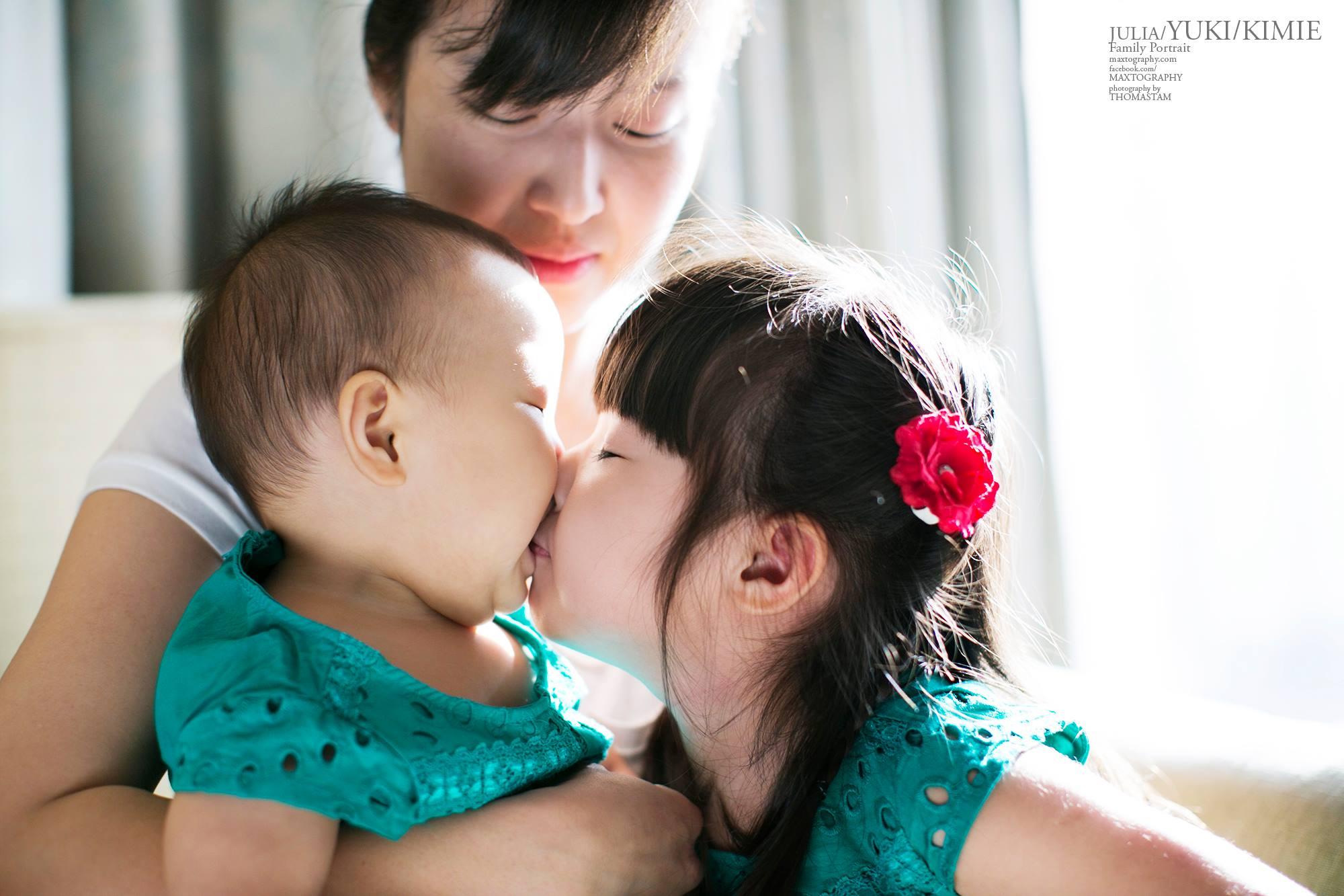 sister kissing sister