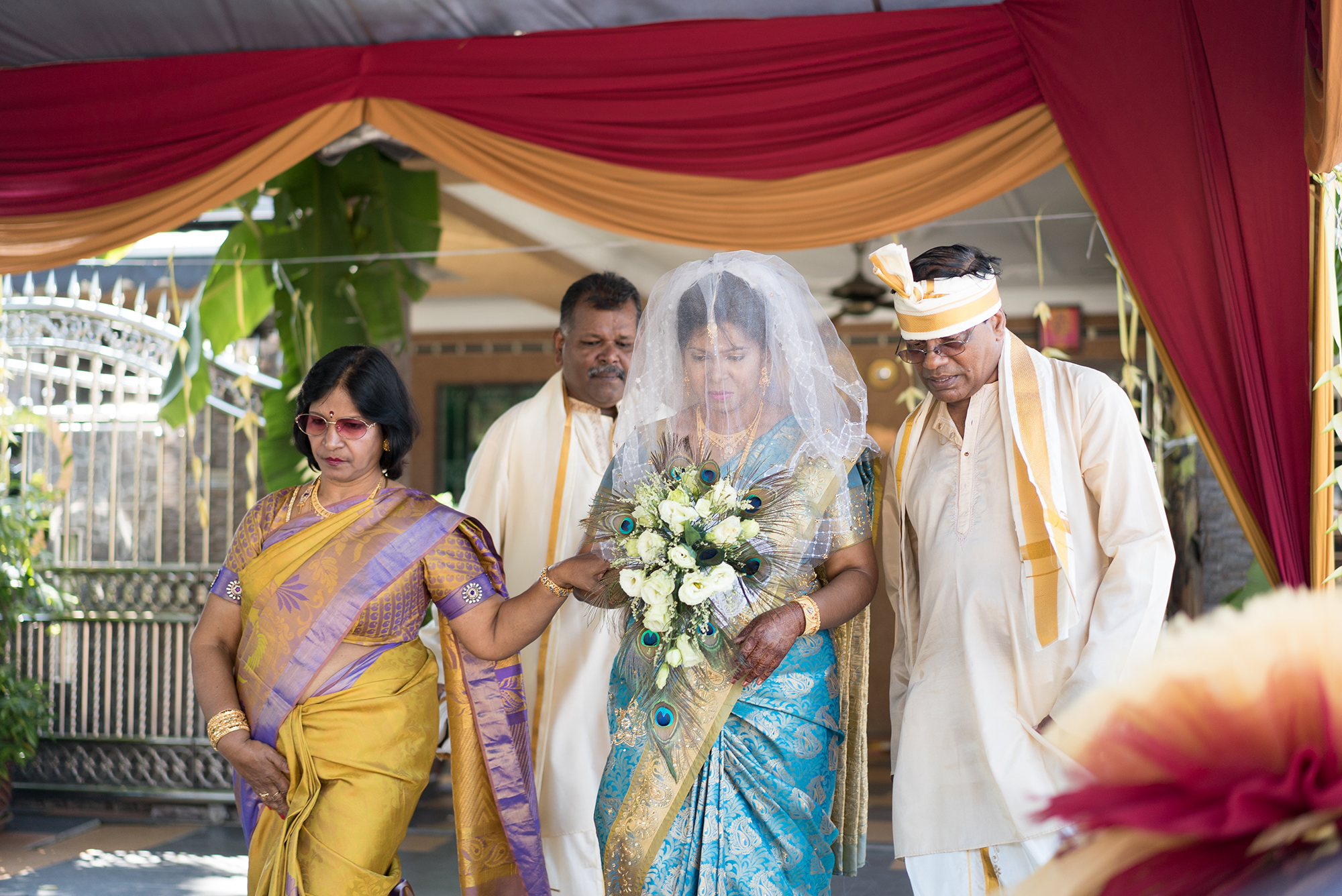 Bride accompanying by her parents