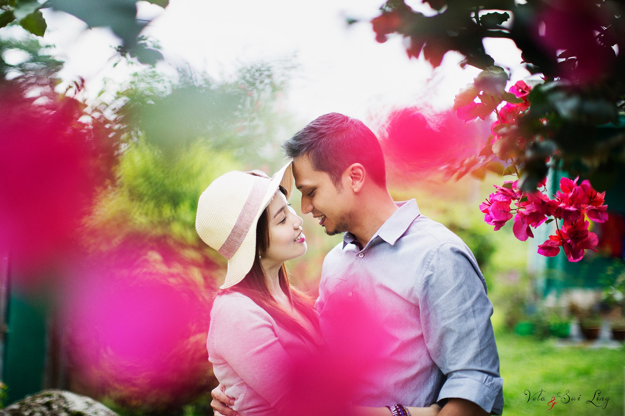 Couple kissing surrounded by flowers at Cameron Highland