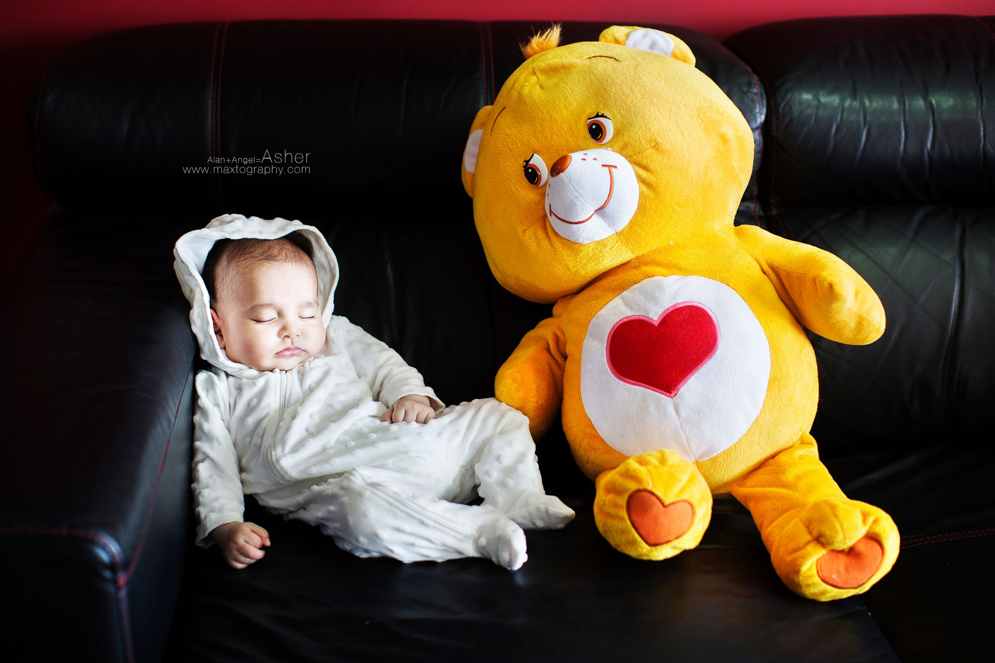 baby with bear toy